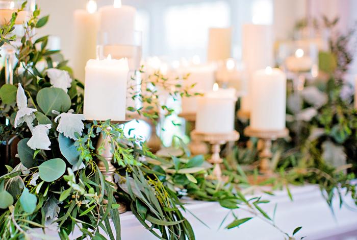 pillar candles and gold candlesticks