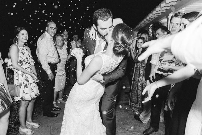 groom dipping bride