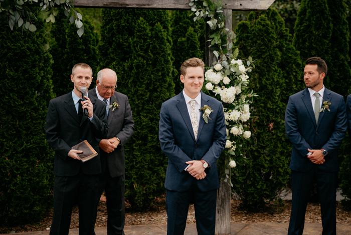 groom waiting on bride