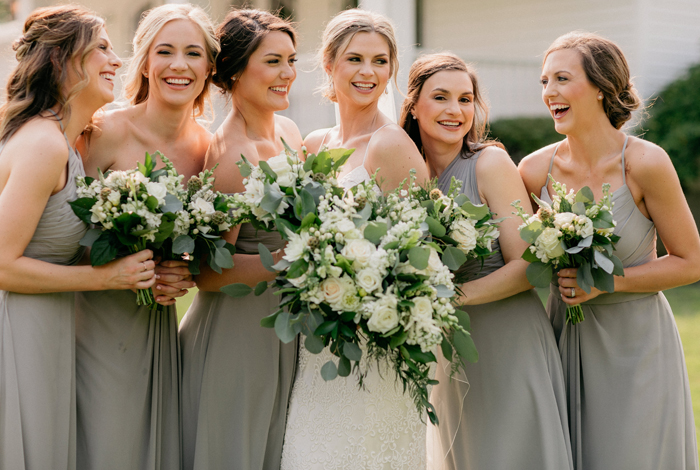 white bouquets with greenery